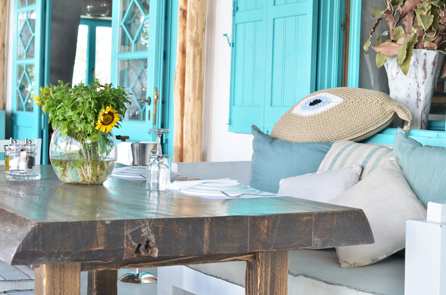Evil Eye cushion in restaurant, Mykonos, Greece / Stasha Travel and Fashion Blog