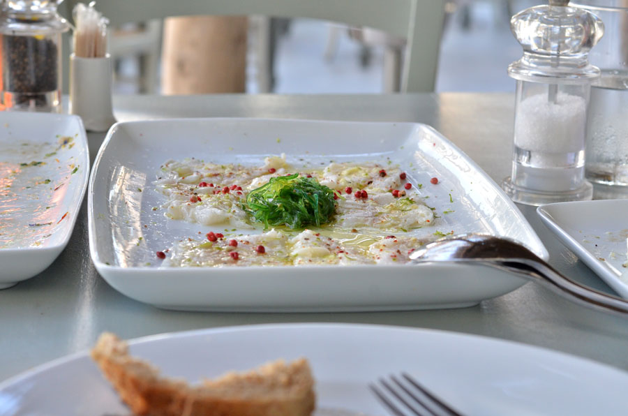 lovely Restaurant sea bass carpaccio in Mykonos, Greece - Stasha Travel and fashion Blog