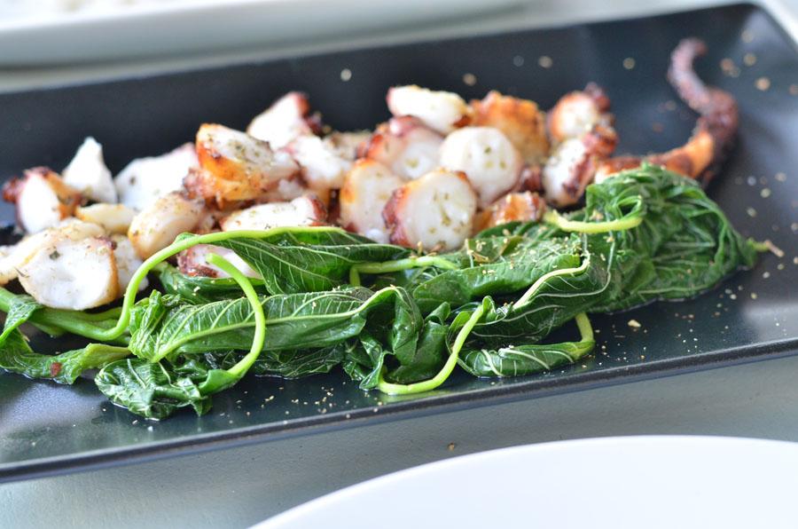 fresh grilled octopus in restaurant, Mykonos, Greece / Stasha Travel and Fashion Blog